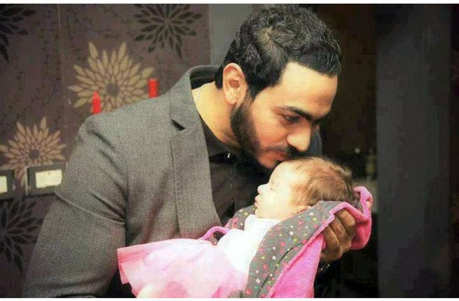 Image of Tamer with his daughter courtesy of www.alonota.com