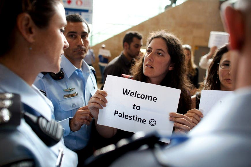 Left wing Israeli activists are arrested by Israeli police as they demonstrate in favor of the 'Welcome to Palestine' fly-in protest.