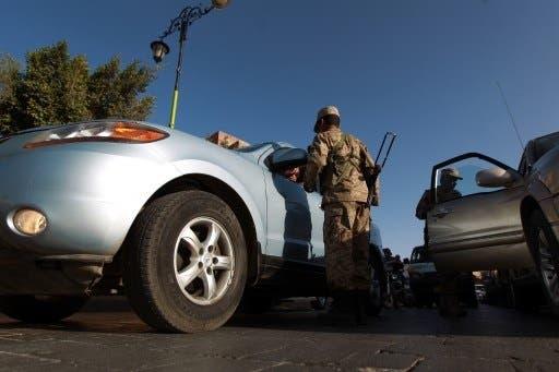 The Al Qaeda gunmen shot the three soldiers at a checkpoint Saturday (Mohammed Huwais/AFP)