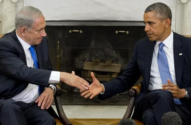 US President Barack Obama (R) and Israeli Prime Minister Benjamin Netanyahu shake hands during a meeting in the Oval Office of the White House. (Image Credit: AFP)