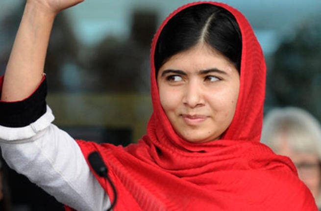 Malala Yousafzai waves during the official opening of Birmingham's library. [gaurdian]