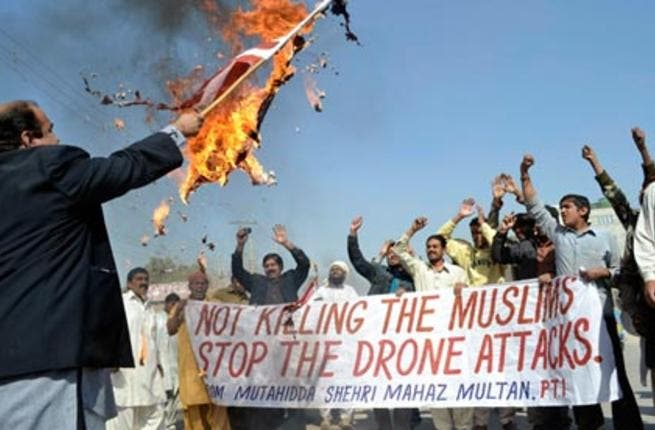 Pakistani men protest against drone strikes. The report said a study showed 74% of Pakistanis considered the US an enemy. [Getty]