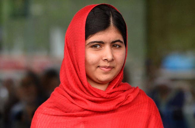 Photo taken on September 3, 2013 shows Malala Yousafzai, the 16-year-old Pakistani advocate for girls education who was shot in the head by the Taliban in 2012, opening the Library of Birmingham. (Image credit: AFP)