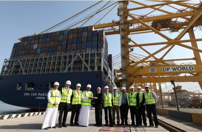 Mohammed Al Muallem, Senior Vice President and Managing Director, DP World, UAE Region, presenting the plaque to Captain Igor Sikic, Master of the ship in the presence of other DP World and CMA CGM officials at Jebel Ali Terminal 2