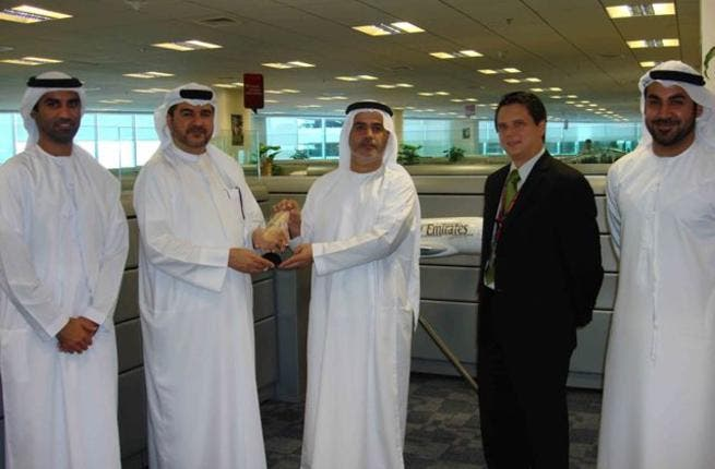 Saeed Mohammed Ahmad, Senior Vice President, Procurement & Logistics Airline Services at Emirates Airlines receives honorary trophy from Abdulrahman Qassim Al Ali, Commercial Sales Manager at Emarat