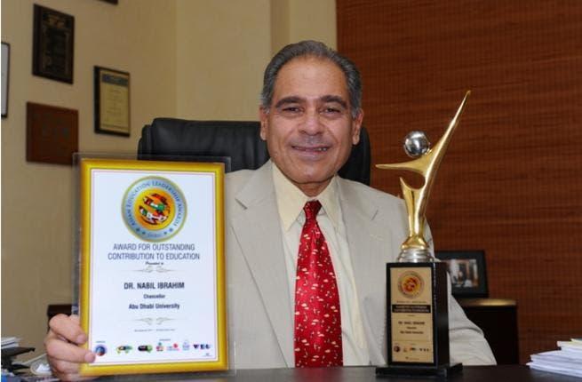 Abu Dhabi University's Chancellor, Dr. Nabil Ibrahim receiving his award