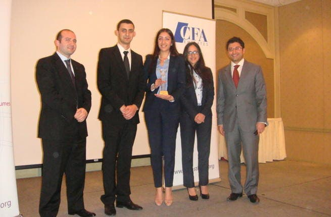 Winning team with Yacoub Nuseibeh and Mohit Malhotra from CFA Emirates