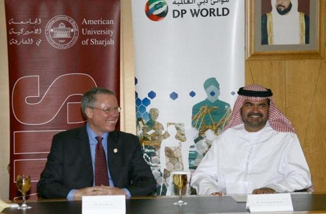 Mohammed Al Muallem and Dr. Peter Heath at the signing ceremony