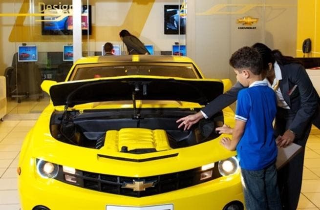 A child learning about the Chevrolet Camaro's features at Kidzania