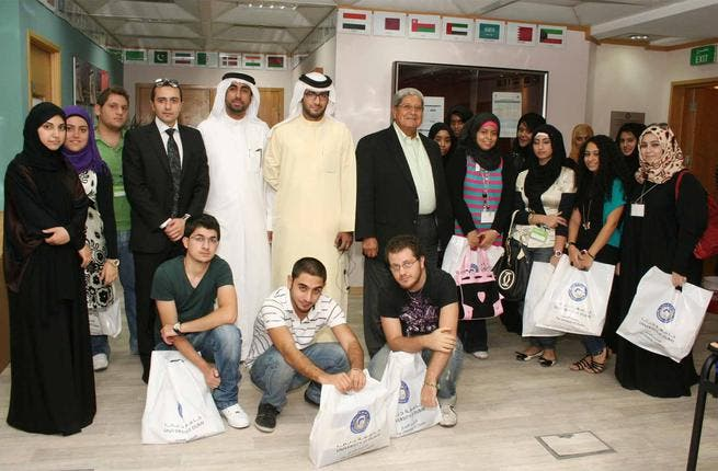 A group photo of new students with Dr Omar Hefni, UD President