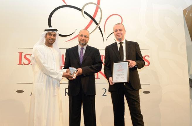 Abdulkadir Hussain receiving the award