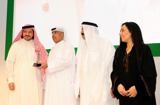 Abdulwahed Juma, Head of Corporate Affairs at FGB recieves award during ceremony