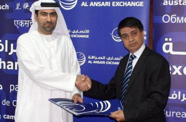 Chandra Prasad Dhakal, Executive Chairman of International Money Express and Rashed Ali Al Ansari, General Manager of Al Ansari Exchange taken after signing the agreement.