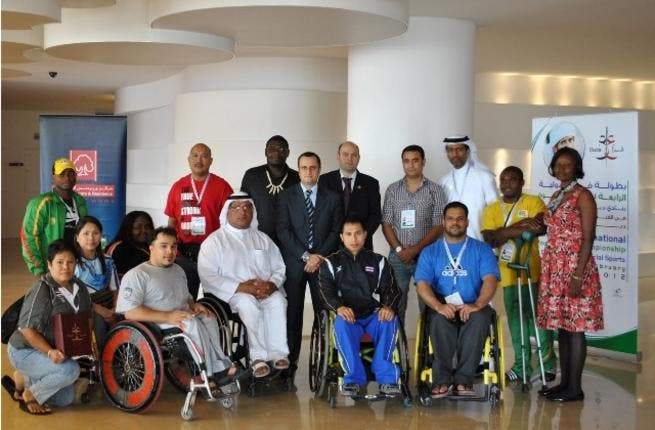 Al Bustan officials with players of Special Olympics