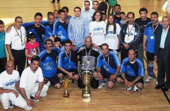 Arab Bank Champions with Executives