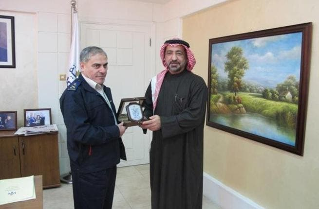 Ahmed Butti Ahmed exchanging gifts with Galib Al-Saraera, Director General of the Jordanian Customs