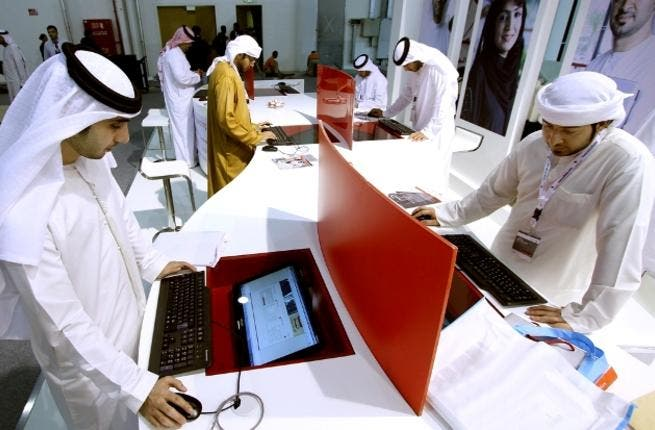 Applicants applying for jobs at the municipal system's stand at Tawdheef
