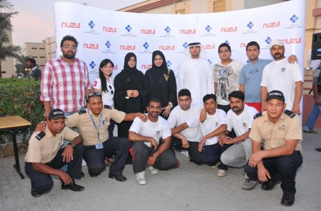 DPG officials with tenants in Nuzul during the event