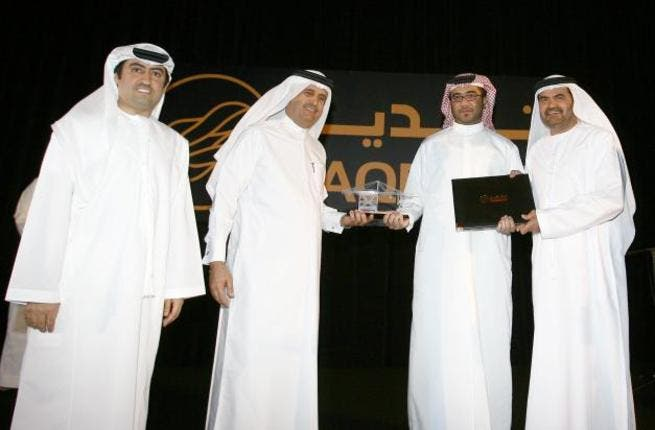 Jamal Majid Bin Thaniah, Joint Vice Chairman; Mohammed Al Muallem, Senior Vice President and Managing Director, DP World UAE; and Mohammed Ali Ahmed, Director of Strategic Planning, DP World UAE at the award ceremony