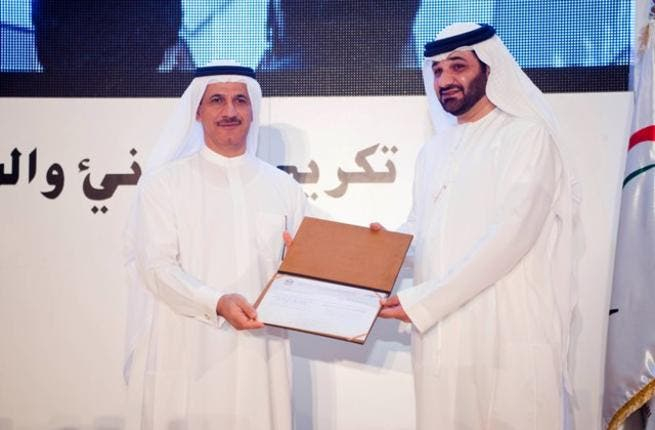 Sultan Al Mansouri, UAE Minister of Economy, presenting award to Mahmood Amin, CEO, Group Security and World Security