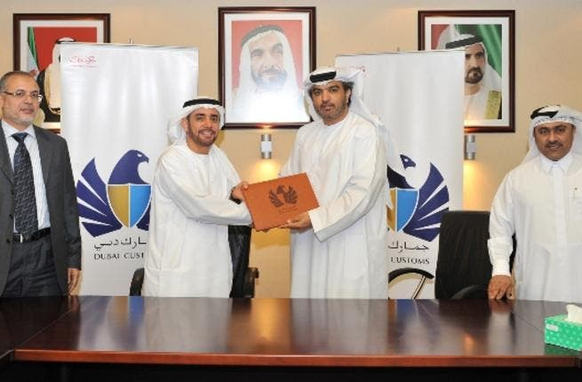 Mr. Yousef Al Sahlawi handing Khalid Al Sherawi the 1st PCW Management License during the meeting between Dubai Customs and GSL