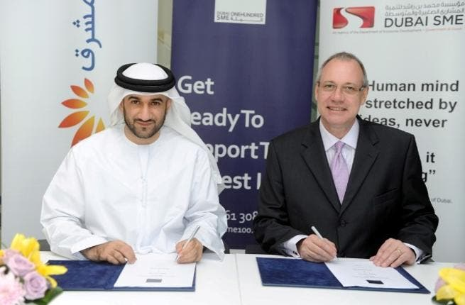 Abdul Baset, Chief Executive Officer of Dubai SME and Douglas Beckett, Head of Retail Banking Group at Mashreq during the signing