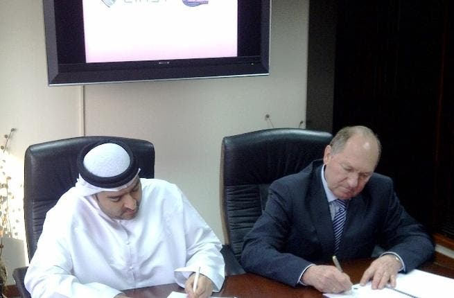 Ahmed Obaid Al Mansoori, Director General of EIAST, and Dr. Vladimir Andreev, Director General of ISCK, signing the contract