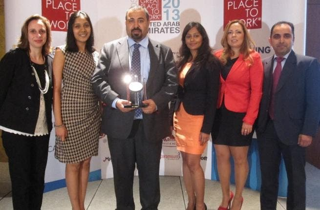 EMC Middle East's HR Team accepts the Top 10 'Great Place To Work' 2013 Award
