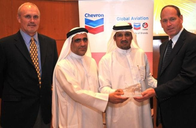 Saeed Abdullah Khoory, ENOC's Chief Executive Officer receiving the Chevron Global Aviation President's Award from Martin Donohue, Chevron's Vice President of Africa, Middle East and Pakistan