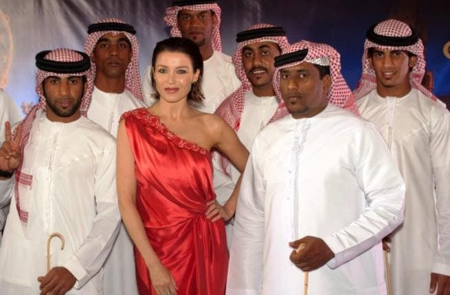 Etihad brand ambassador Dannii Minogue with traditional Emirati dancers at Etihad's cocktail reception in Melbourne