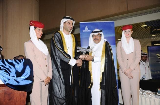 Ahmed Khoory presents Abdulla Al Tassan with a crystal Emirates A380 aircraft