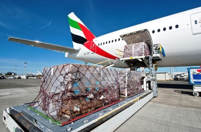 Emirates Airlines' Boeing 777-300 is loaded with relief supplies for victims of the Somalia civil war