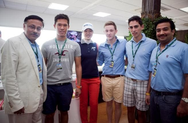 Emirates NBD Senior Officials with Students of Emerging World Youth Golf programme.