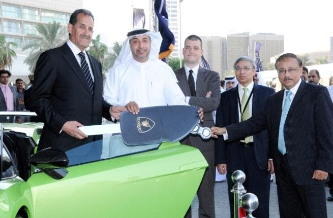 Emirates NBD top officials handing the keys of the Lamborghini Gallardo to Latif Mohammad