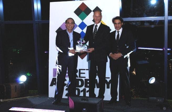 Eros representative receiving the award