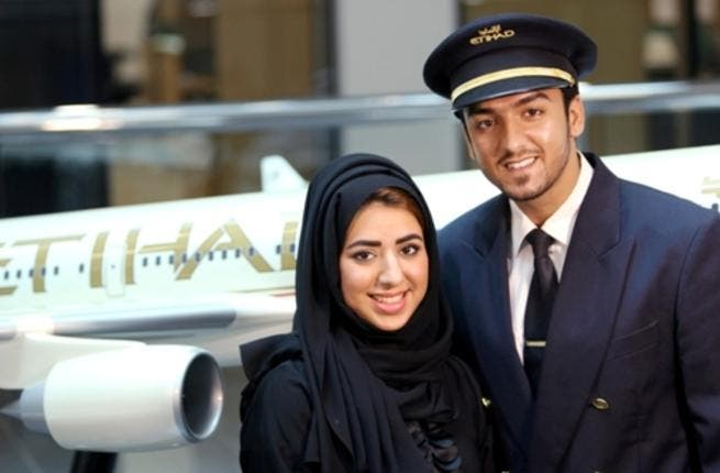 Noora Al Marri, Etihad Airways' 1,000th Emirati member of staff, with her husband, Faisal Al Naqbi, an officer cadet from batch 19 of the cadet pilot program