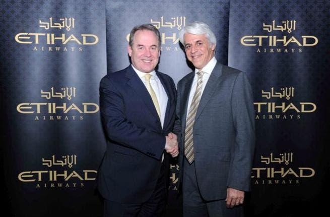 James Hogan, CEO, Etihad Airways and Michel Taride, President Hertz International, Executive Vice President, Hertz Corporation celebrate the new global partnership