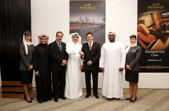 Ahmed Al Halyan, Etihad's Country Manager Qatar and Peter Baumgartner, Etihad's Chief Commercial Officer, with representatives from Etihad Airways and Qatar Civil Aviation Authority