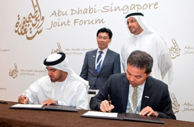 Falah Al Ahbabi,, General Manager, Abu Dhabi Urban Planning Council signing the MoU