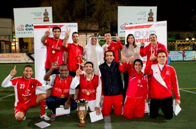 Mr. Fawzy Al-Thunayan, General Manager of Board Affairs and Ms. Salma Al Hajjaj, General Manager of Human Resources at Gulf Bank along with the winning team