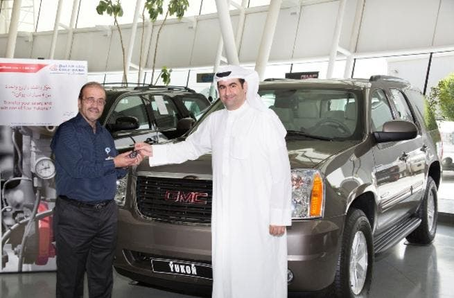 Yaser Sulaiman, Executive Manager, Consumer Banking at Gulf Bank handing the car keys to, Allam Ahmed Shadid, the 1st Quarterly KOC draw winner