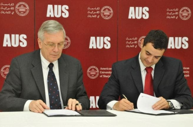 DeBin, Vice Chancellor for Finance and Administration,AUS and Sam Alkharrat, managing director, SAP during the signing