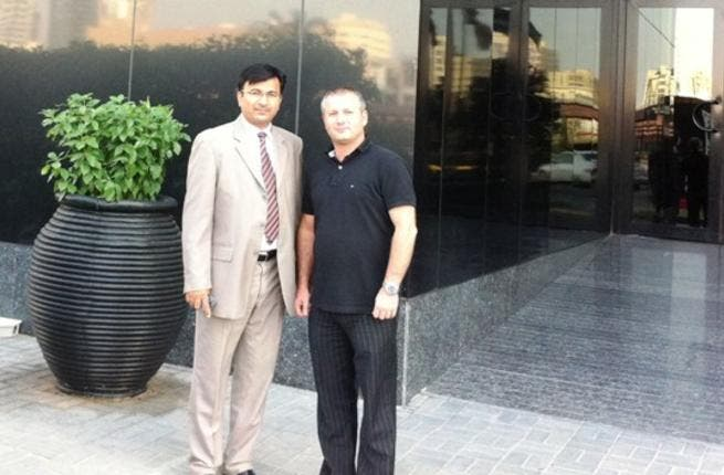 Iftikhar Hamdani, General Manager of Ramada Ajman Hotel receiving Daniel Esvandi, Senior Product Manager of JT Touristik