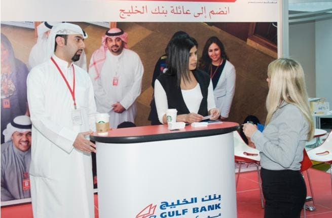 A member of the Gulf Bank team explaining the application process