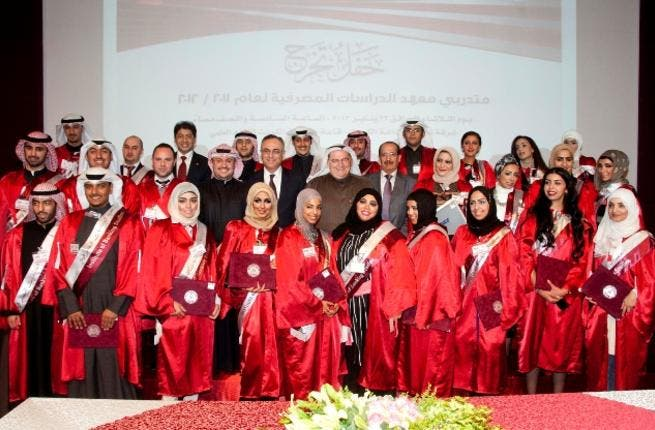 Gulf Bank management along with staff after receiving their certificates