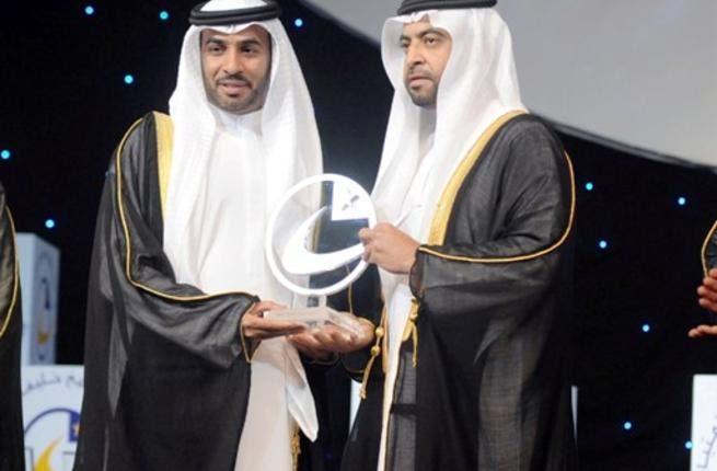 Ali Saeed Bin Harmal Al Dhaheri, Chairman of ADU Executive Board receiving the award