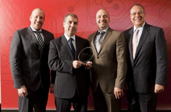 Executives from Brocade receiving award
