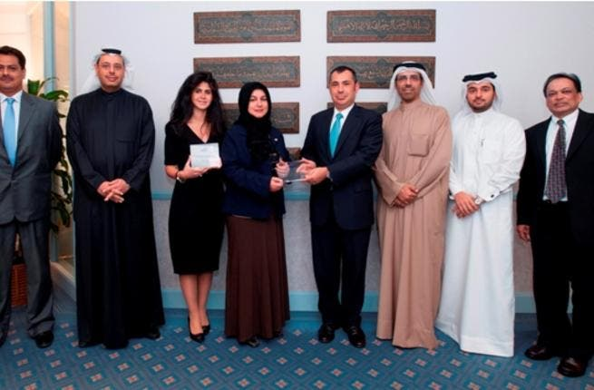 A group photo of Gulf Bank's team receiving two Quality Recognition awards from Citibank representatives