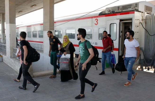 Iraqi passengers disembark from a train coming from Baghdad as it arrives in the city of Fallujah in Anbar province, about 70 kilometers west of the capital. (AFP)