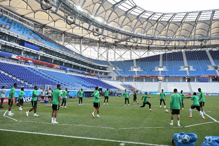 Saudi Arabia's players play with a ball during a training session at the Volgograd Arena in Volgograd on June 24, 2018, on the eve of the Russia 2018 World Cup Group A football match between Saudi Arabia and Egypt. NICOLAS ASFOURI / AFP